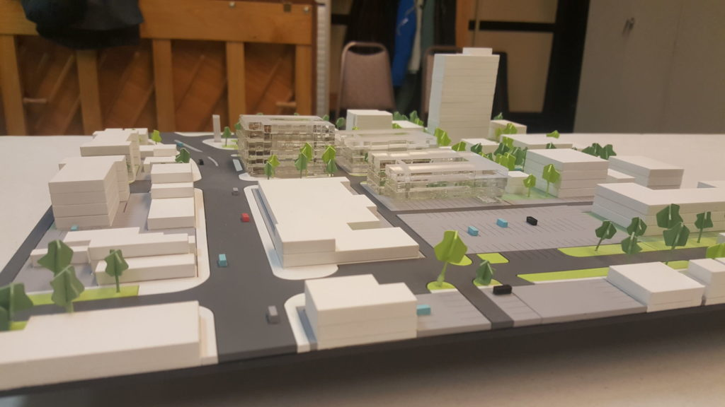 Model shows the massing of three new developments (clear blocks) proposed for the site of the former Osborne Village Inn.